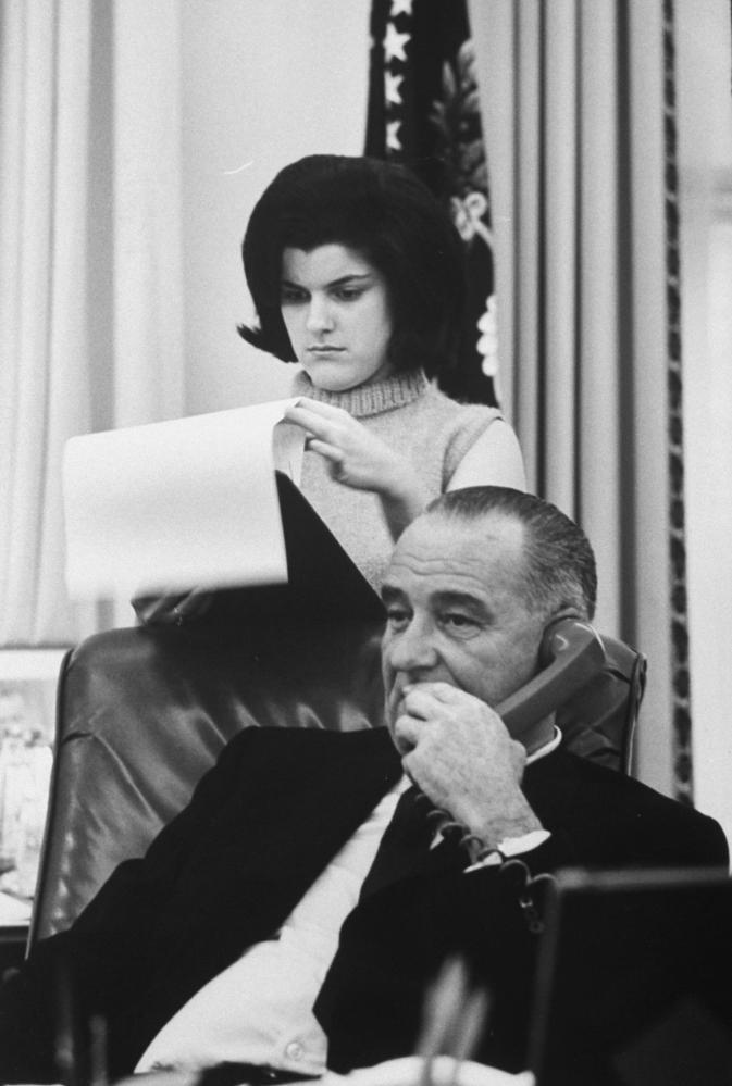 Lyndon Johnson with his daughter Luci in the White House.