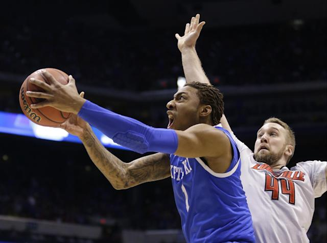 Kentucky's James Young (1) drives past Louisville's Stephan Van Treese (44) during the first half of an NCAA Midwest Regional semifinal college basketball tournament game Friday, March 28, 2014, in Indianapolis. (AP Photo/Michael Conroy)