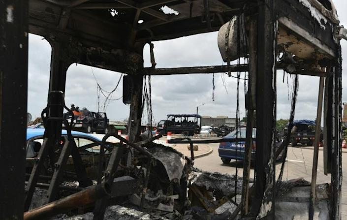 In the economic capital Abidjan, protesters torched a bus in the working-class district of Yopougon on Monday