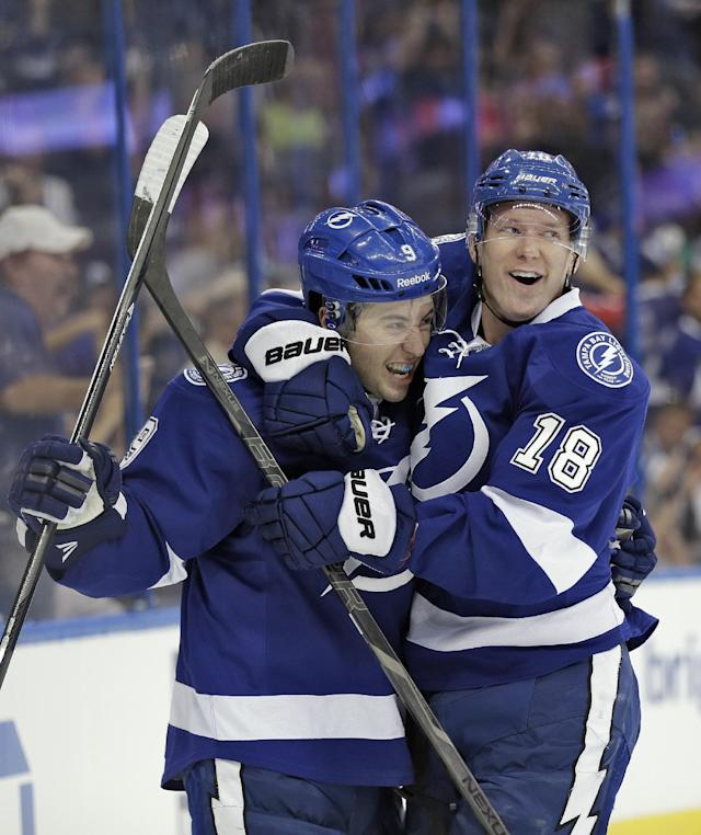 Tampa Bay Lightning center Tyler Johnson (9) celebrates with teammate left wing Ondrej Palat (18), of the Czech Republic, after Johnson scored against the Edmonton Oilers during the second period of an NHL hockey game on Thursday, Nov. 7, 2013, in Tampa, Fla. (AP Photo/Chris O'Meara)