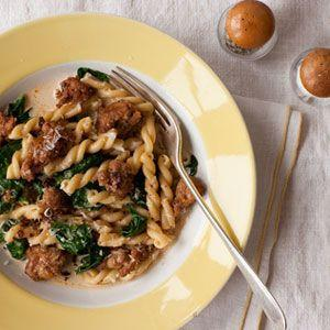 """<p>The secret to this dish's rich, creamy sauce is a touch of nutmeg. Your family will be asking what you did to make it taste so good.</p><p><strong><a href=""""https://www.countryliving.com/food-drinks/recipes/a32500/gemelli-spicy-sausage-spinach-recipe-122640/"""" rel=""""nofollow noopener"""" target=""""_blank"""" data-ylk=""""slk:Get the recipe"""" class=""""link rapid-noclick-resp"""">Get the recipe</a>.</strong></p><p><strong><a class=""""link rapid-noclick-resp"""" href=""""https://www.amazon.com/Patented-Strainer-Handles-Nonstick-Ti-Cerama/dp/B071L32Q8W/?tag=syn-yahoo-20&ascsubtag=%5Bartid%7C10050.g.32969162%5Bsrc%7Cyahoo-us"""" rel=""""nofollow noopener"""" target=""""_blank"""" data-ylk=""""slk:SHOP PASTA POTS"""">SHOP PASTA POTS</a><br></strong></p>"""