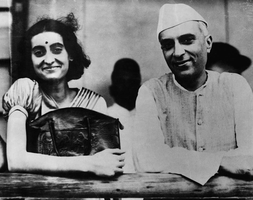 Indira Nehru with her father Pandit Jawaharlal Nehru, President of the Indian Congress, before she left Bombay for England, to study at Oxford University. (Photo by © Hulton-Deutsch Collection/CORBIS/Corbis via Getty Images)