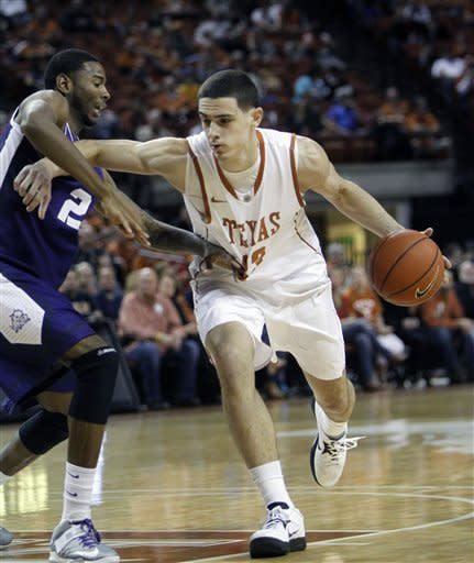 Texas forward Ioannis Papapetrou, right, drives around TCU forward Connell Crossland during the first half of an NCAA college basketball game, Saturday, Feb. 2, 2013, in Austin, Texas. (AP Photo/Michael Thomas)