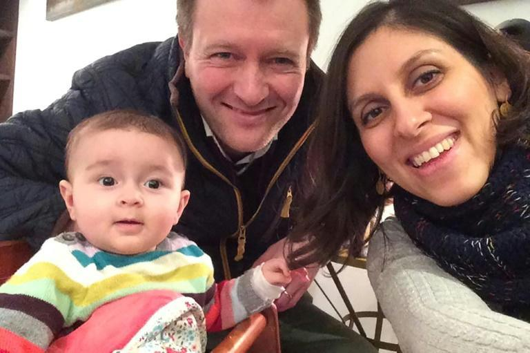 This undated file handout image released by the Free Nazanin campaign in London on June 10, 2016 shows Nazanin Zaghari-Ratcliffe (R) posing for a photograph with her husband Richard and daughter Gabriella (L)