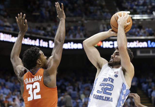 North Carolina's Luke Maye (32) shoots while Clemson's Donte Grantham (32) defends during the first half of an NCAA college basketball game in Chapel Hill, N.C., Tuesday, Jan. 16, 2018. (AP Photo/Gerry Broome)