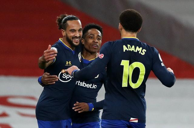 Theo Walcott (left) netted against his old team