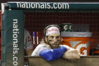 Philadelphia Phillies right fielder Bryce Harper stands in the dugout during the ninth inning of the team's baseball game against the Washington Nationals, Thursday, Sept. 26, 2019, in Washington. Washington won 6-3. (AP Photo/Patrick Semansky)