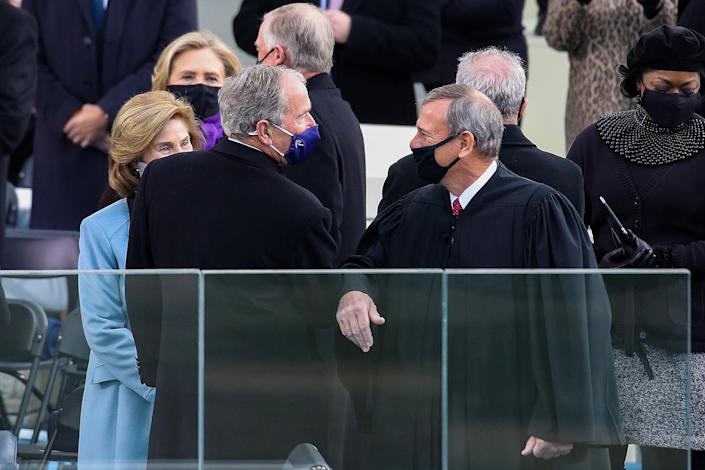 <p>Former President George W. Bush greets Supreme Court Chief Justice John Roberts with an elbow bump in front of the United States Capitol. </p>