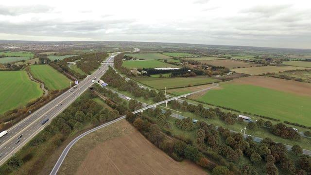 Undated handout artist's impression issued by Highways England of how the Lower Thames Crossing junction with the M25 in Essex will look (Highways England/PA)