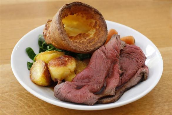 A traditional British Sunday lunch of roast beef and yorkshire pudding, is photographed in Canteen restaurant in London.