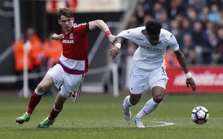 Britain Football Soccer - Swansea City v Middlesbrough - Premier League - Liberty Stadium - 2/4/17 Middlesbrough's Marten de Roon in action with Swansea City's Leroy Fer Action Images via Reuters / Andrew Boyers Livepic