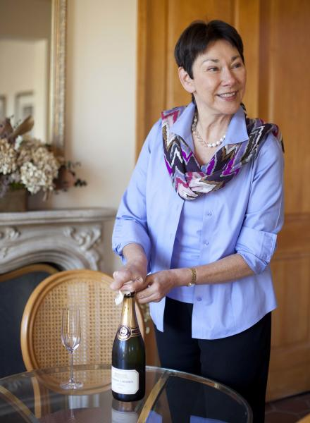 In this photo taken Wednesday, Nov. 14, 2012, CEO and winemaker Eileen Crane opens a bottle of Brut Cuvee sparkling wine at Domaine Carneros in Napa, Calif. Something new is bubbling up in the world of cocktails, using sparkling wine as a mixer. (AP Photo/Eric Risberg)