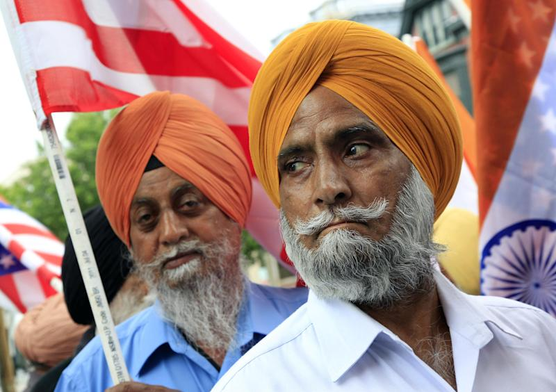 Nachhatar Singh, right, and Gill Harjit wait to join several hundred supporters outside the New Jersey Statehouse in Trenton, N.J., Monday, May 14, 2012, on behalf of Dharun Ravi, the former Rutgers University student convicted of bias intimidation for using a webcam to see his roommate kissing another man. The case garnered national attention because his roommate, Tyler Clementi, killed himself in September 2010, just days after the spying. (AP Photo/Mel Evans)