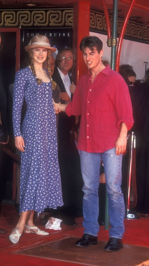 Accompanying Tom Cruise to his Hand and Footprint ceremony at Grauman's Chinese theatre, LA in 1993