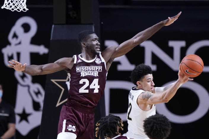 Mississippi State forward Abdul Ado (24) defends against Vanderbilt guard Scotty Pippen Jr. (2) in the second half of an NCAA college basketball game Saturday, Jan. 9, 2021, in Nashville, Tenn. (AP Photo/Mark Humphrey)