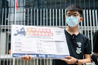 "Prominent democracy campaigner Joshua Wong tweeted the new law ""marks the end of Hong Kong that the world knew before. With sweeping powers and ill-defined law, the city will turn into a #secretpolicestate"""