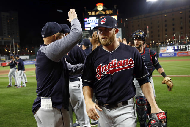 Cleveland Indians relief pitcher Cody Allen, right, walks off the field after closing out a baseball game against the Baltimore Orioles, Monday, April 23, 2018, in Baltimore. (AP Photo/Patrick Semansky)