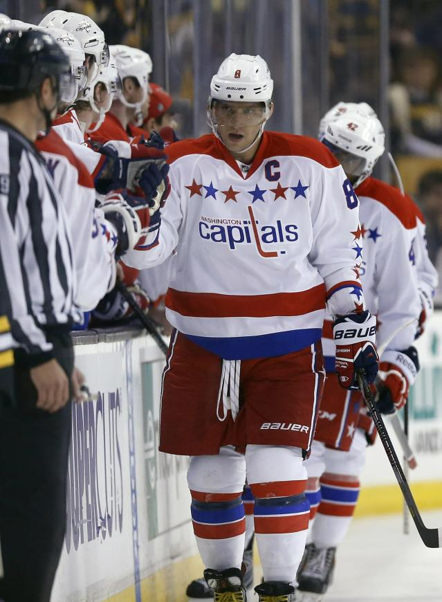 Washington Capitals' Alex Ovechkin (8) celebrates his goal in the second period of an NHL hockey game against the Boston Bruins in Boston, Saturday, March 1, 2014. (AP Photo/Michael Dwyer)