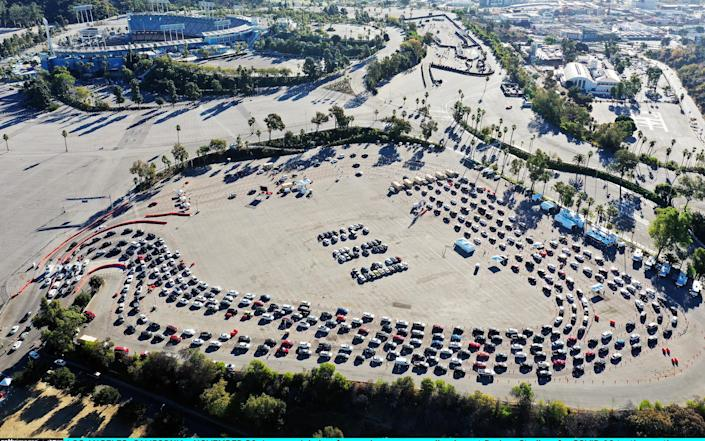 Cars are lined up at Dodger Stadium in LA for Covid-19 testing on the Monday after Thanksgiving weekend - Getty
