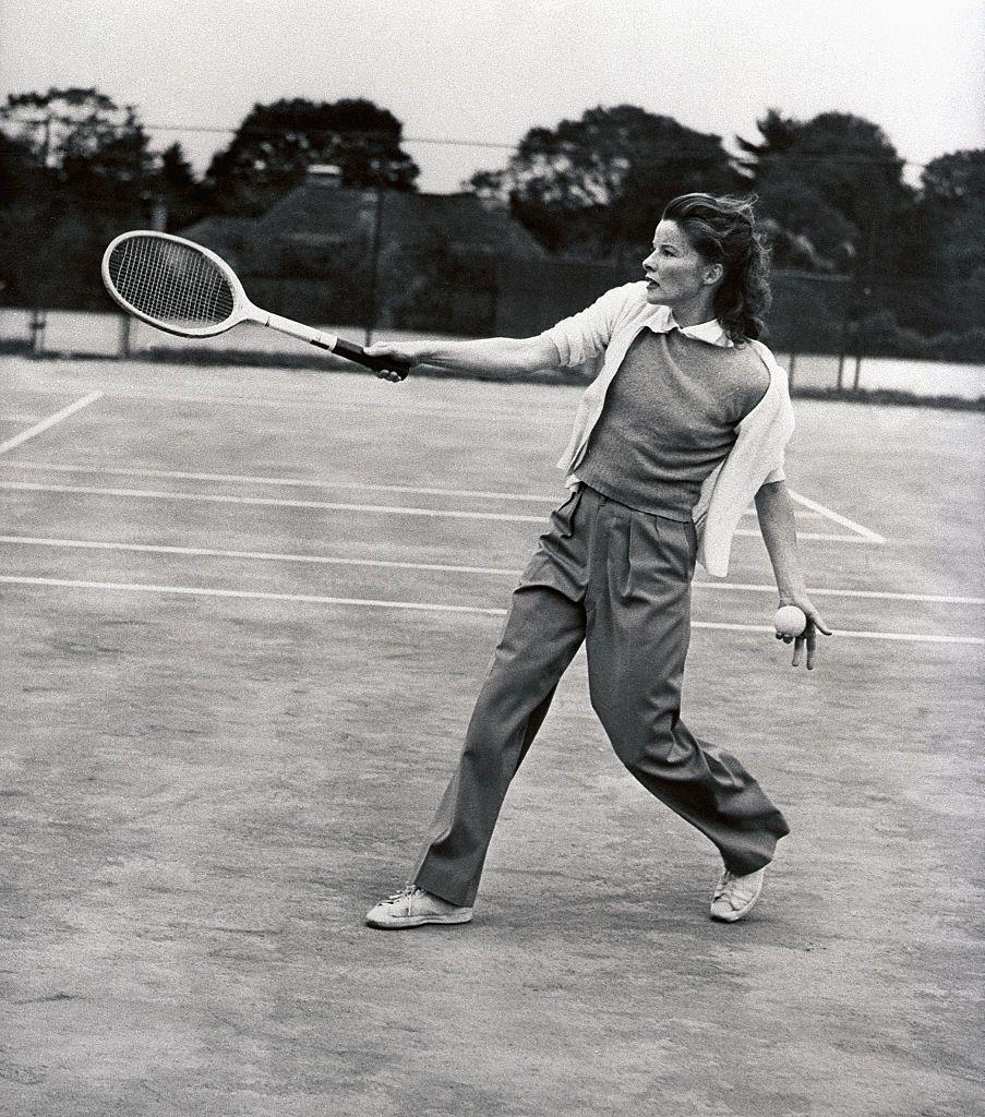 <p>Katharine Hepburn demonstrates her follow-through, as she hits the tennis court at Merion Cricket Club in 1940. </p>