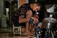 Borneo FC footballer Andri Muliadi packs coffee as he tries to make ends meet during the Indonesian league's coronavirus shutdown