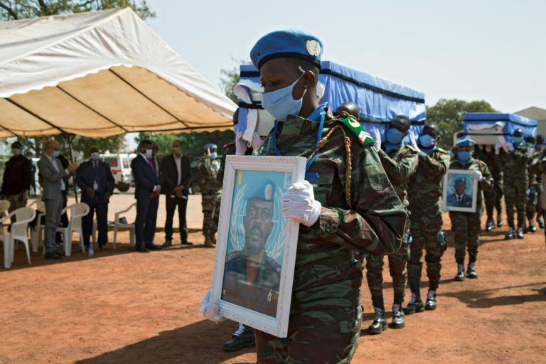 MINUSMA troops carry the coffins of four Ivorian comrades who were killed by a roadside bomb in northwestern Mali on January 13