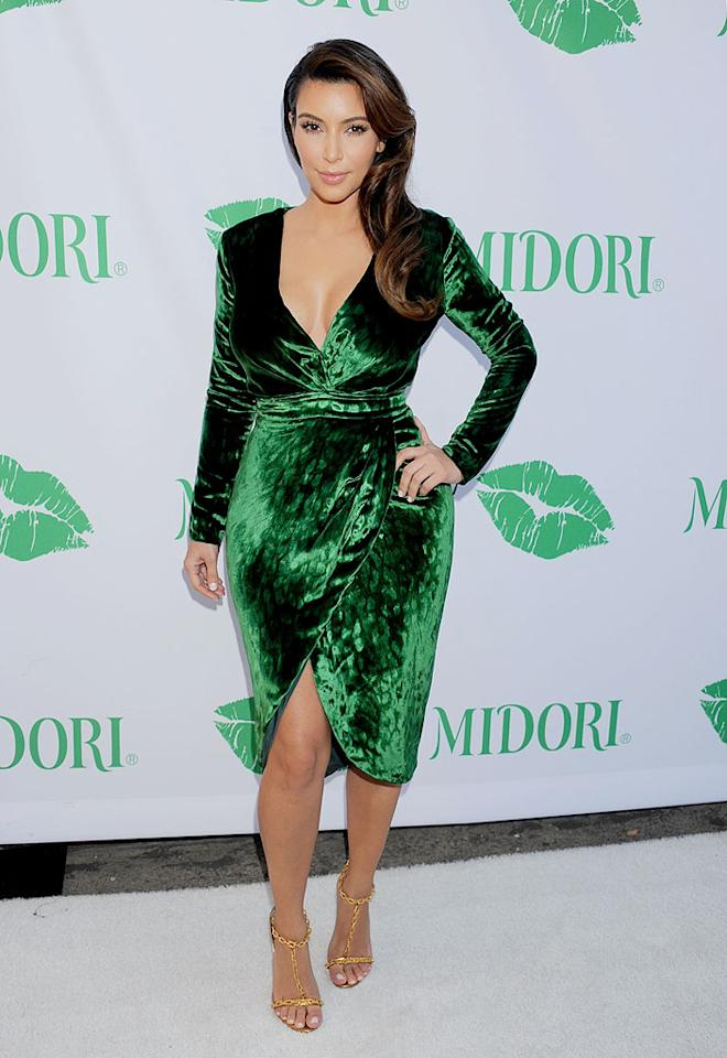 The luck of the Irish was not with Kim Kardashian when she hit a Midori event in a green velvet wrap dress that was better-suited for a St. Patrick's Day soiree. The material is hard for most people to wear, and certainly didn't do the curvaceous reality star's figure any favors. (9/25/2012)