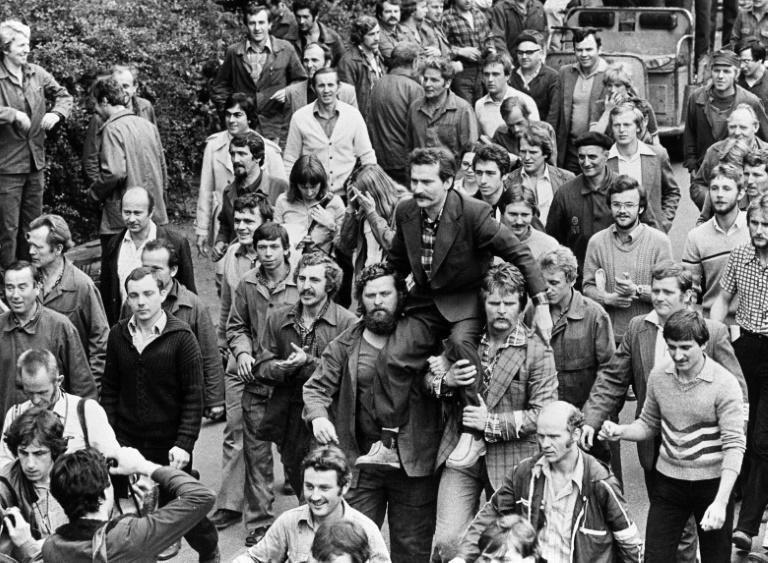 Lech Walesa was carried on fellow dockworkers' shoulders after signing a 1980 pact with Poland's Communist leadership