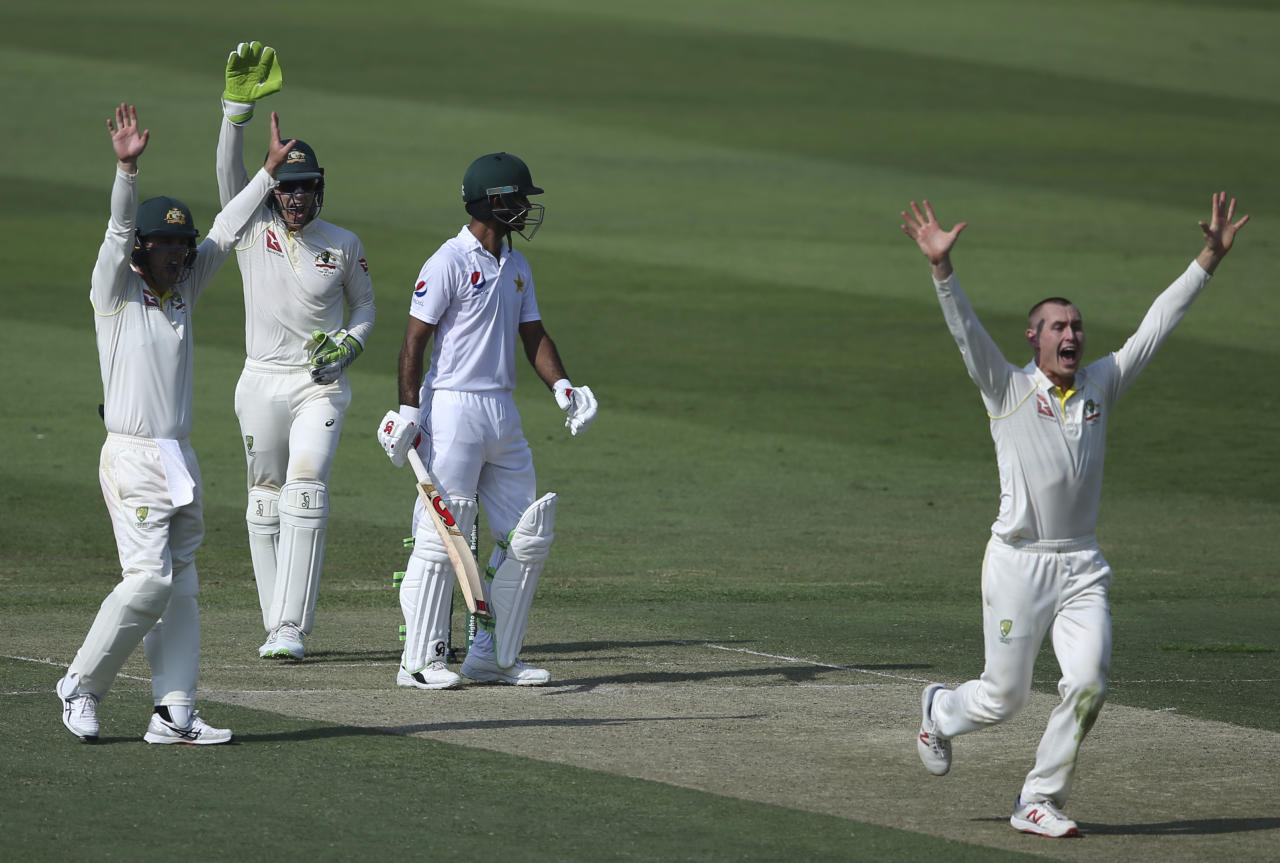 Australia's Marnus Labuschagne, right, appeals the dismissal of Pakistan's Fakhar Zaman during their test match in Abu Dhabi, United Arab Emirates, Tuesday, Oct. 16, 2018. (AP Photo/Kamran Jebreili)
