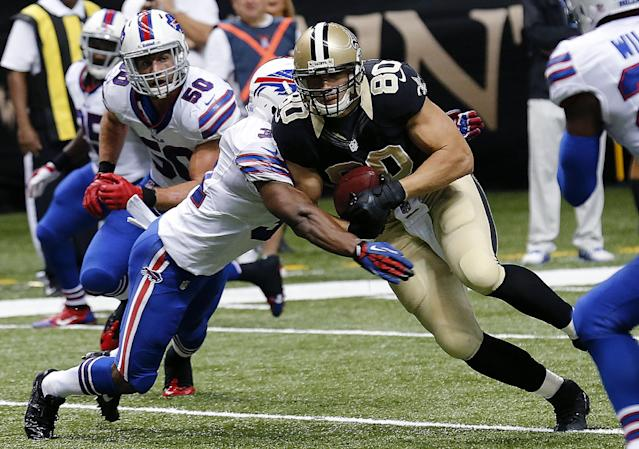 New Orleans Saints tight end Jimmy Graham (80) carries on a touchdown reception as Buffalo Bills free safety Jairus Byrd (31) tries to tackle him during the second half of an NFL football game in New Orleans, Sunday, Oct. 27, 2013. (AP Photo/Bill Haber)