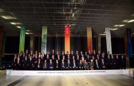 Finance ministers and Central Bank presidents pose for the official photo at the G20 Meeting of Finance Ministers in Buenos Aires