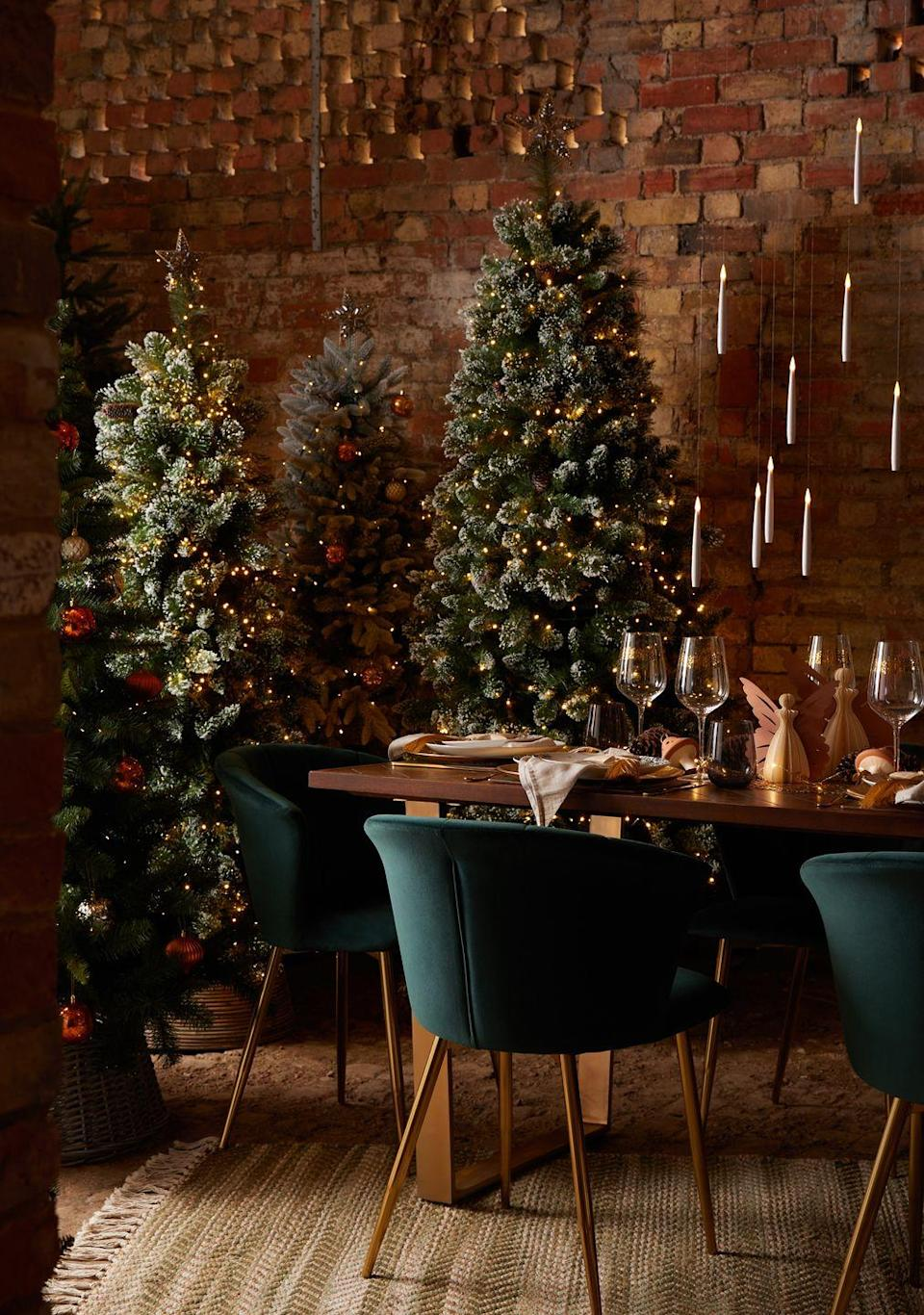 """<p>As part of Dunelm's Winter Solstice trend, you'll discover gorgeous rich hues (think bottle greens and berry reds), plus glitter-free decorations, stylish <a href=""""https://www.housebeautiful.com/uk/decorate/looks/g22581402/christmas-tree-skirts/"""" rel=""""nofollow noopener"""" target=""""_blank"""" data-ylk=""""slk:tree skirts"""" class=""""link rapid-noclick-resp"""">tree skirts</a>, and cute woodland animal figurines. Christmas might be a long way off, but the new range is certainly getting us excited for the holidays...</p>"""
