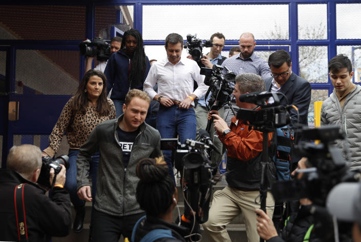Democratic presidential candidate former South Bend, Ind., Mayor Pete Buttigieg is surrounded by media as he visits a caucus site Saturday, Feb. 22, 2020, in Las Vegas. (AP Photo/John Locher)