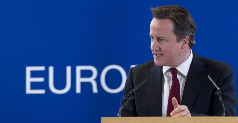 British Prime Minister David Cameron gestures while speaking during a media conference at an EU summit in Brussels on Friday, March 15, 2013. On the second anniversary of an uprising that evolved into Syria's brutal civil war, the European Union's national leaders will likely discuss whether to arm rebels trying to overthrow the regime of Bashar Assad. (AP Photo/Virginia Mayo)