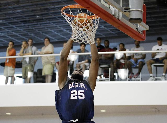 Detroit Pistons' Andre Drummond makes a dunk during a USA Basketball minicamp scrimmage Monday, July 28, 2014, in Las Vegas. (AP Photo/John Locher)
