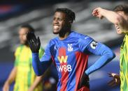Crystal Palace's Wilfried Zaha reacts during the English Premier League soccer match between Crystal Palace and West Bromwich Albion at Selhurst Park stadium in London, England, Saturday, March 13, 2021.(Mike Hewitt/Pool via AP)