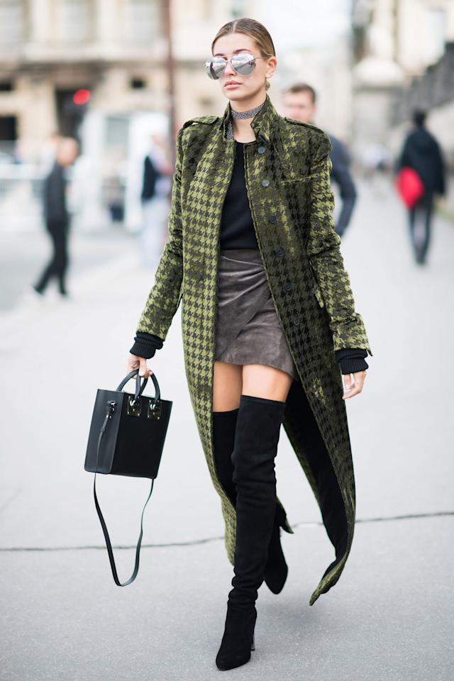 <p>Hailey Baldwin wears a Haider Ackerman jacket, YProject shirt, Bec and Bridge skirt, and Dior boots to the Elie Saab fashion show in Paris on Oct. 1, 2016.</p>