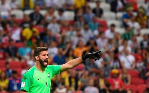 Brazil's goalkeeper Alisson speaks to his teammates during the Russia 2018 World Cup quarter-final football match - Credit: Getty Images