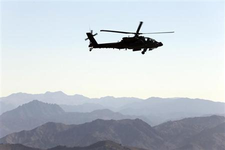 A U.S Army Apache helicopter flies near the town of Walli Was during an operation in Paktika province, near the border with Pakistan