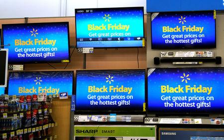 Advertisements of the upcoming Black Friday sales are seen on TV screens at a Walmart store in Westminster