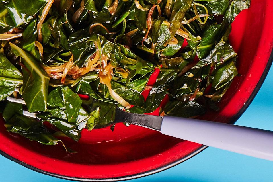 "This recipe for collard greens, sweetened with golden-brown onions and brightened with a splash of coconut vinegar, comes from chef Sarah Kirnon of Miss Ollie's in Oakland. <a href=""https://www.epicurious.com/recipes/food/views/sauteed-collard-greens-and-sweet-onion-with-paprika?mbid=synd_yahoo_rss"" rel=""nofollow noopener"" target=""_blank"" data-ylk=""slk:See recipe."" class=""link rapid-noclick-resp"">See recipe.</a>"