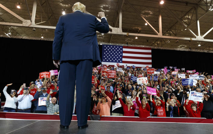 The crowd cheers as President Donald Trump arrives to speak at a rally at the IX Center, in Cleveland, Monday, Nov. 5, 2018, (AP Photo/Carolyn Kaster)