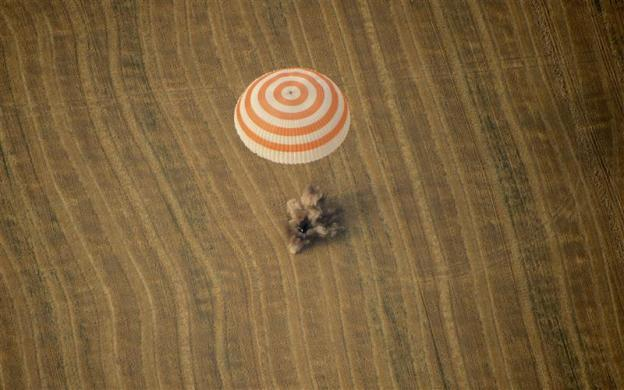 The Soyuz TMA-22 capsule carrying International Space Station (ISS) crew members U.S. astronaut Daniel Burbank and Russian cosmonauts Anton Shkaplerov and Anatoly Ivanishin, lands in Kazakhstan, some 88km (55 miles) north-east of Arkalyk, April 27, 2012.