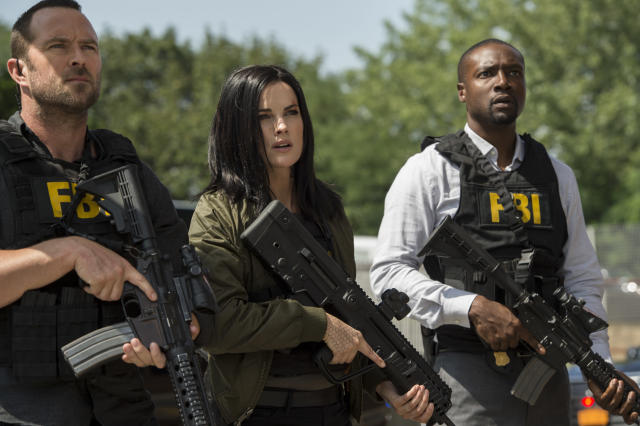 Jaimie Alexander, doing what she does as Jane Doe in NBC's <em>Blindspot,</em> alongside Sullivan Stapleton as Kurt Weller and Rob Brown as Edgar Reade. The show's fall finale airs on Friday, Dec. 22. (Photo: David Giesbrecht/NBC/Warner Bros/NBCU Photo Bank)