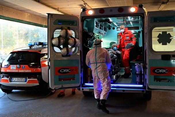 PHOTO: A man is disembarked from an ambulance at the San Carlo hospital in Milan on Oct. 28, 2020, as Europe struggled to contain an alarming surge in COVID-19 cases. (Miguel Medina/AFP via Getty Images)