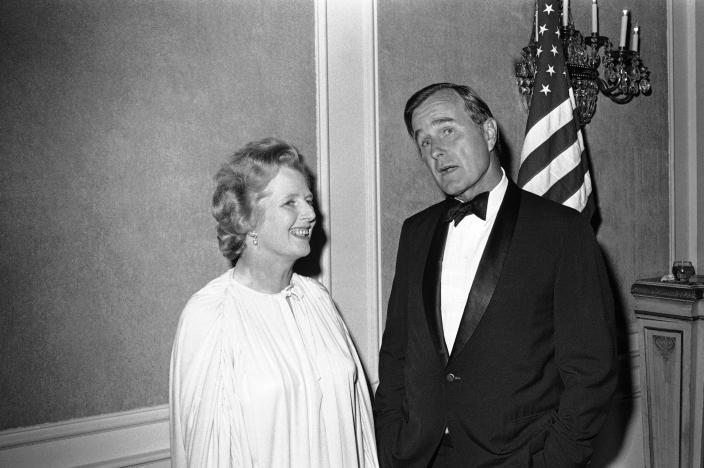 <p>George Bush on Sept. 9, 1977, in Houston, gets ready to introduce Margaret Thatcher, leader of the British Conservative Party, before a dinner where she would address the English-Speaking Union. (Photo: Ed Kolenovsky/AP) </p>