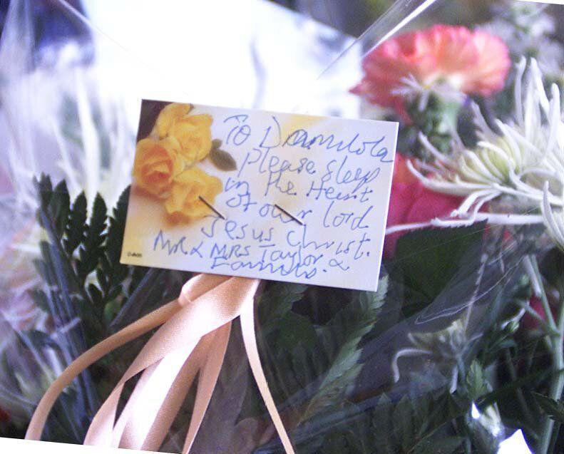 Flowers from the parents, Richard and Gloria Taylor, of murdered 10-year-old Damilola, left while visiting the spot where their son was killed in Peckham. Police hunting the killers of the 10-year-old arrested two youths and a woman in connection with the murder. Detective Superintendent David Dillnutt told a press conference at New Scotland Yard that the arrests were made at 6am at addresses in Southwark, south east London. See PA News story POLICE Boy. PA photo: Sean Dempsey (Photo: PA)