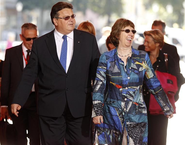 European foreign policy chief Catherine Ashton,right, and Lithuania's Minister of Foreign Affairs Linas Linkevicius arrive for an Informal Meeting of EU Ministers for Foreign Affairs at the National Museum – Palace of the Grand Dukes of Lithuania in Vilnius, Lithuania, Friday, Sept. 6, 2013. (AP Photo/Mindaugas Kulbis)