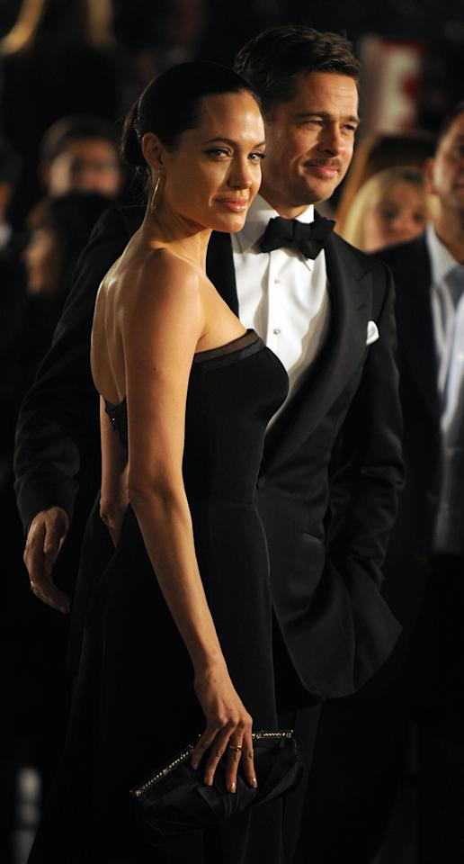 <p>Angelina Jolie and Brad Pitt, who met on the set of <em>Mr. and Mrs. Smith</em>, arrive for the premiere of <em>The Curious Case of Benjamin Button</em> (2008). The couple were together from 2005-2016.</p>