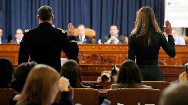 PHOTO: National Security Council aide Lt. Col. Alexander Vindman, left, and Jennifer Williams, an aide to Vice President Mike Pence are sworn in to testify before the House Intelligence Committee on Capitol Hill in Washington, Nov. 19, 2019. (Jacquelyn Martin/AP)